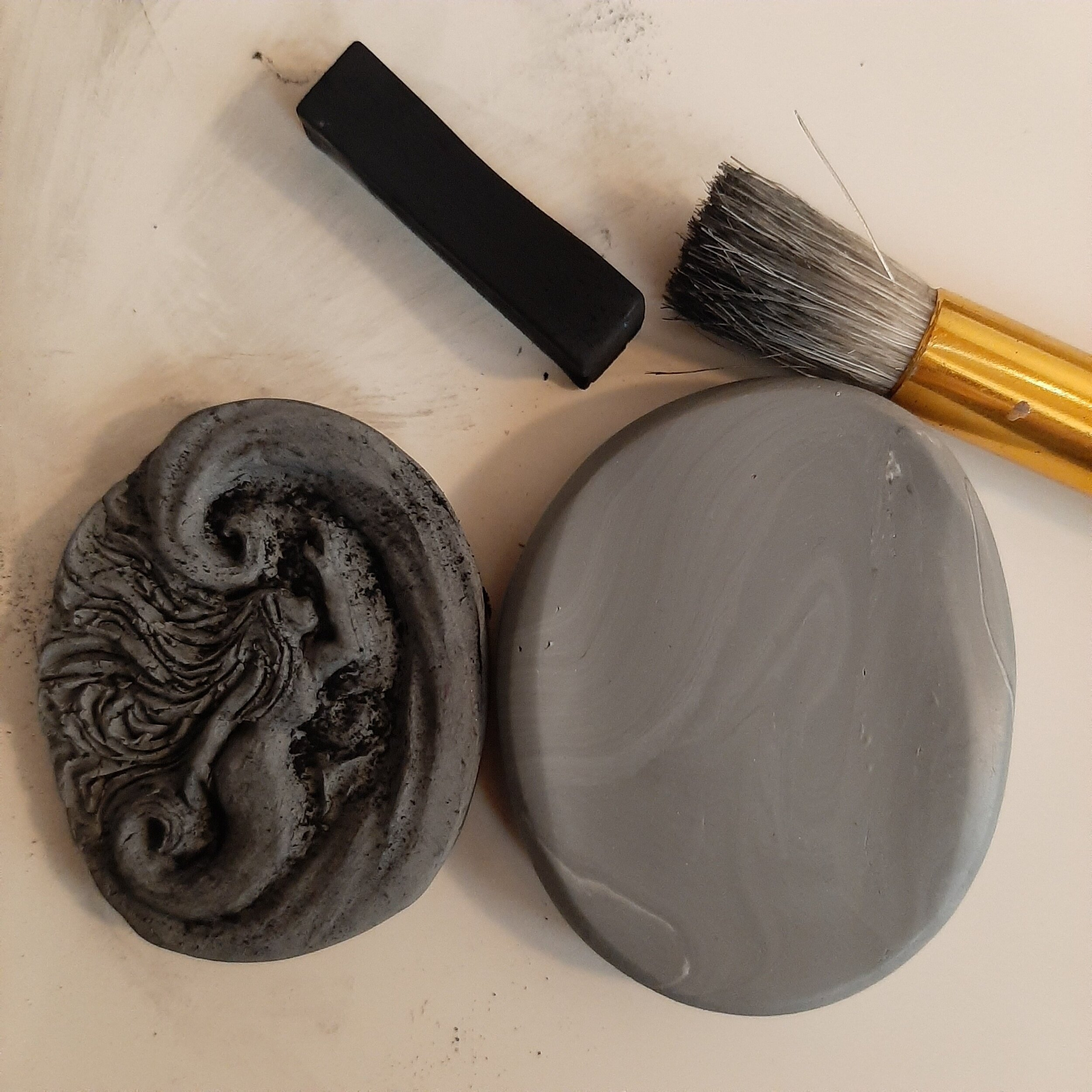 Prepare for a Mold - Condition more clay and roll it out to a little thicker than the baked piece. With chalk pastels, dust the baked piece throughly. (For extra ease of mold release, you can put more directly onto the raw clay.)