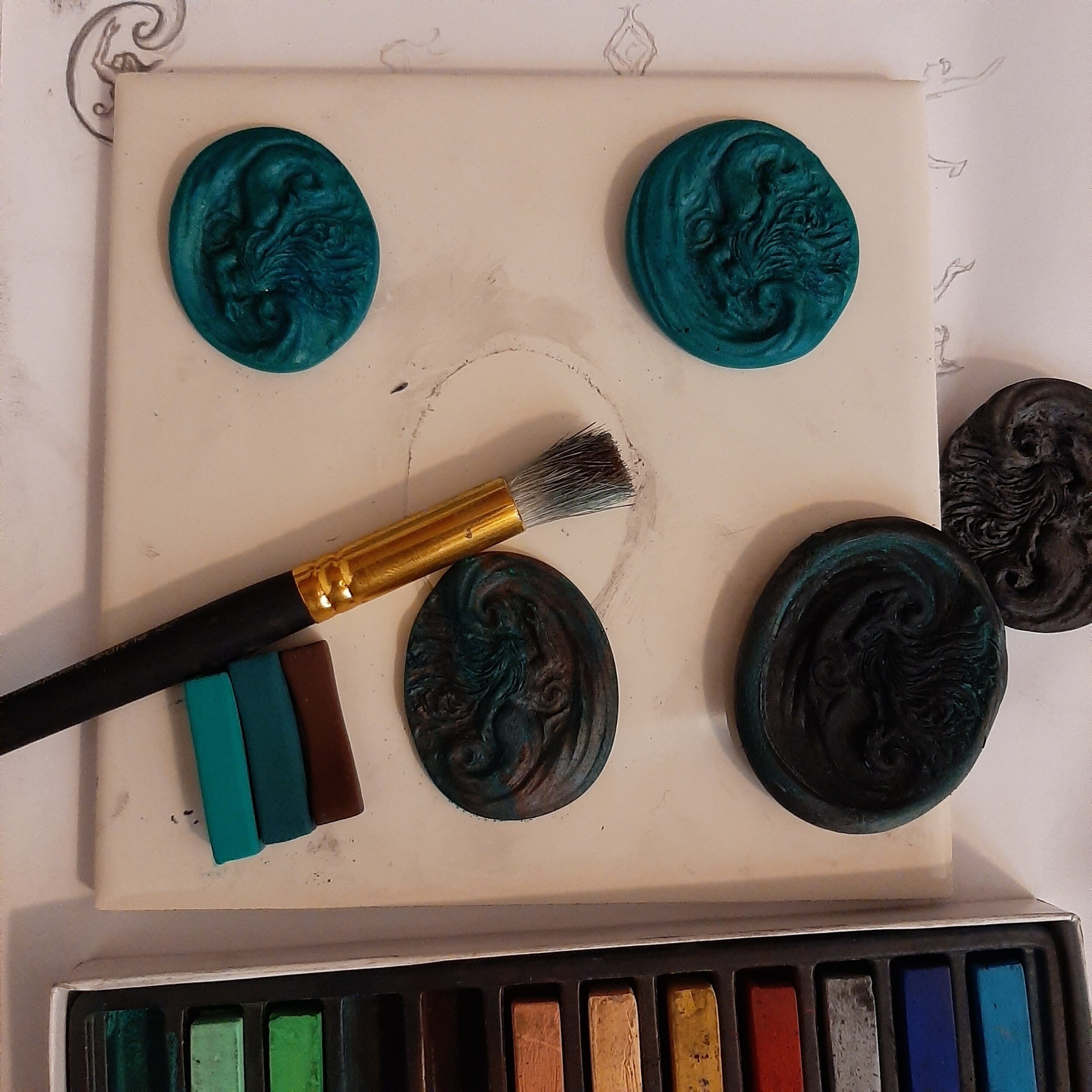 Make Copies - Once you've baked and cooled the mold, you can use more chalk pastels and clay to create copies of your original. I like to start with colors that evoke a copper patina, as I'll be adding copper tones on top.