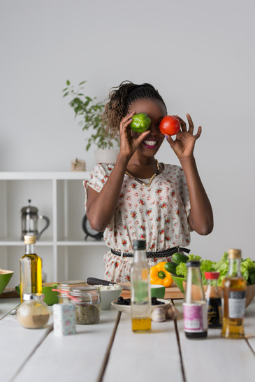 photodune-10455912-young-african-woman-cooking-salad-xs.jpg