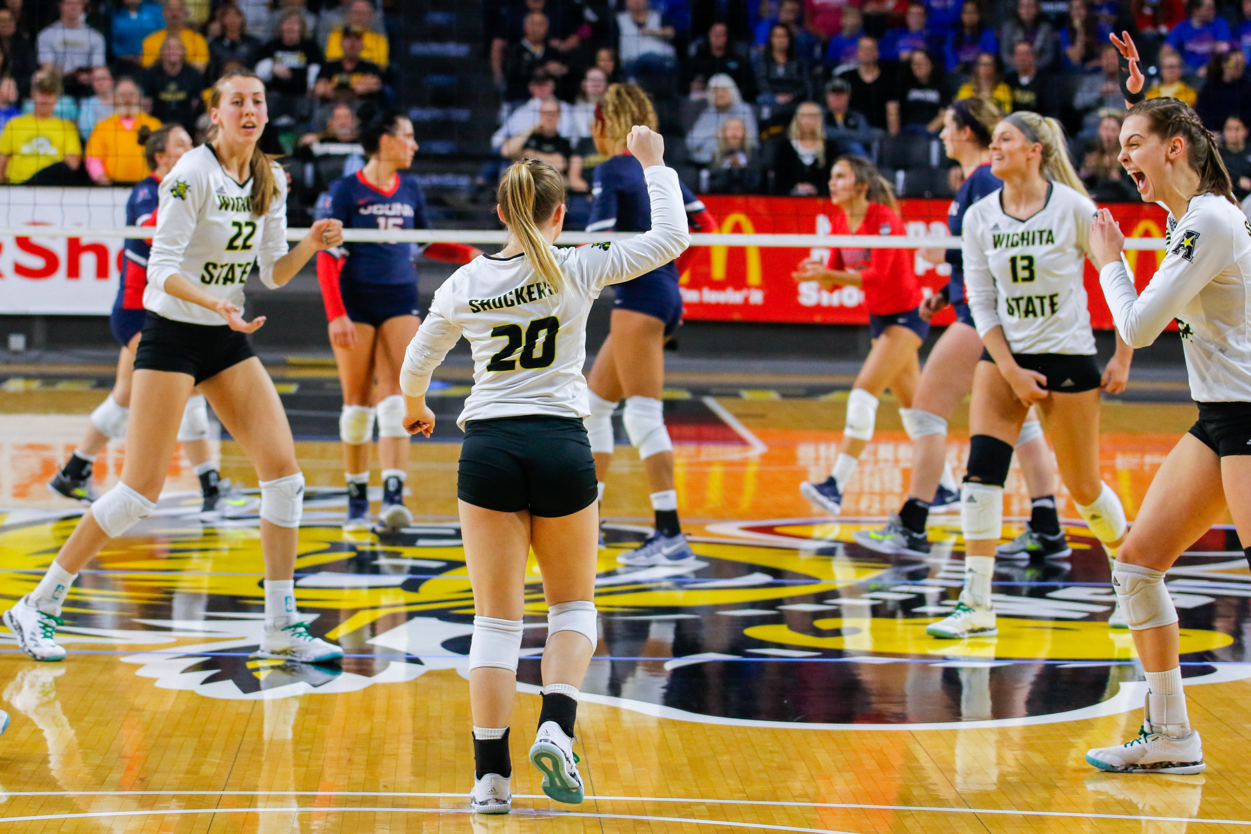 Wichita State celebrates after winning a point against UConn on November 3, 2017 at Charles Koch Arena.
