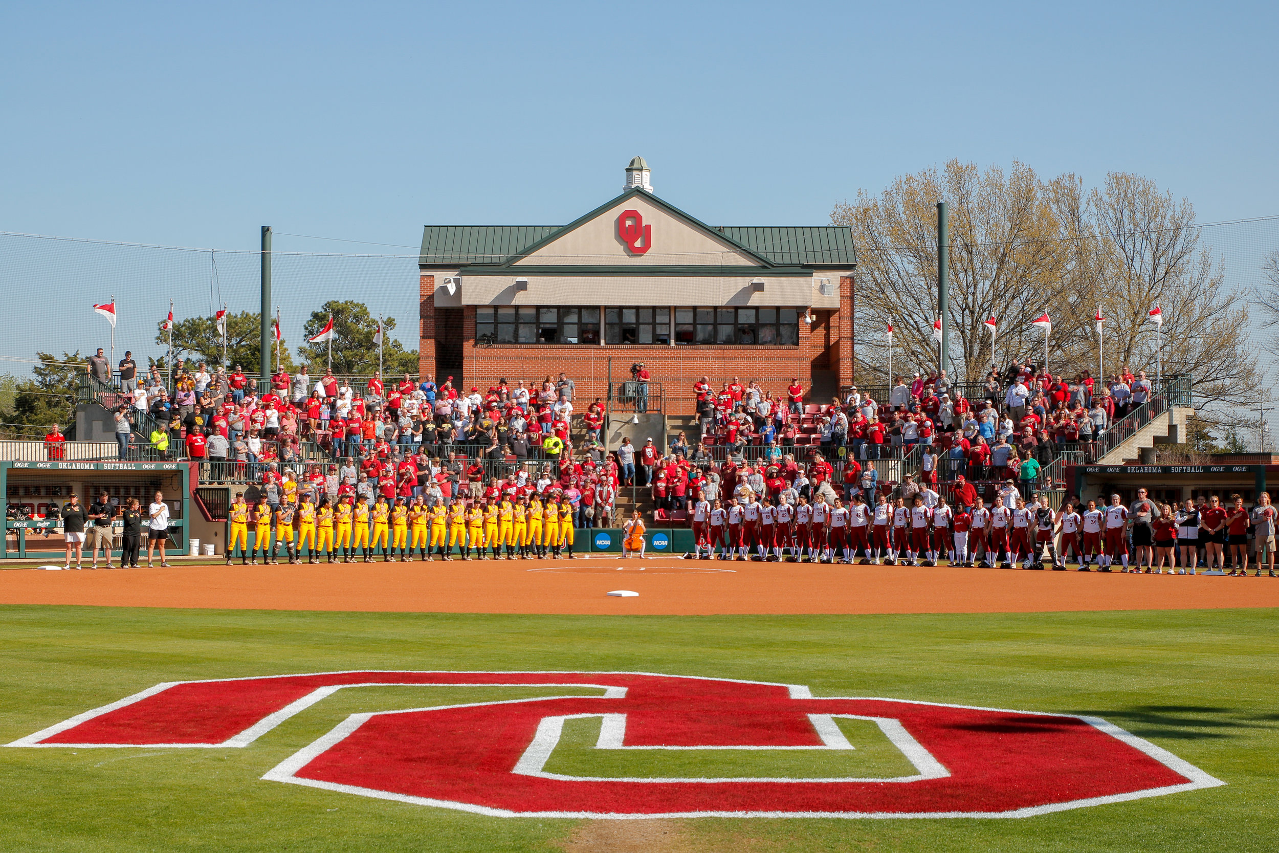 Wichita State and the University of Oklahoma line up before a game in Norman, Oklahoma.