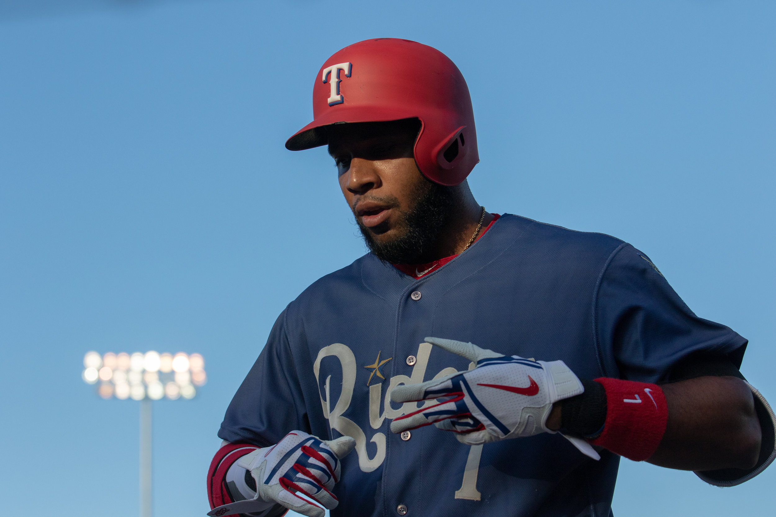 Elvis Andrus walks into the dugout while playing for the Rough Riders on June 14, 2018.