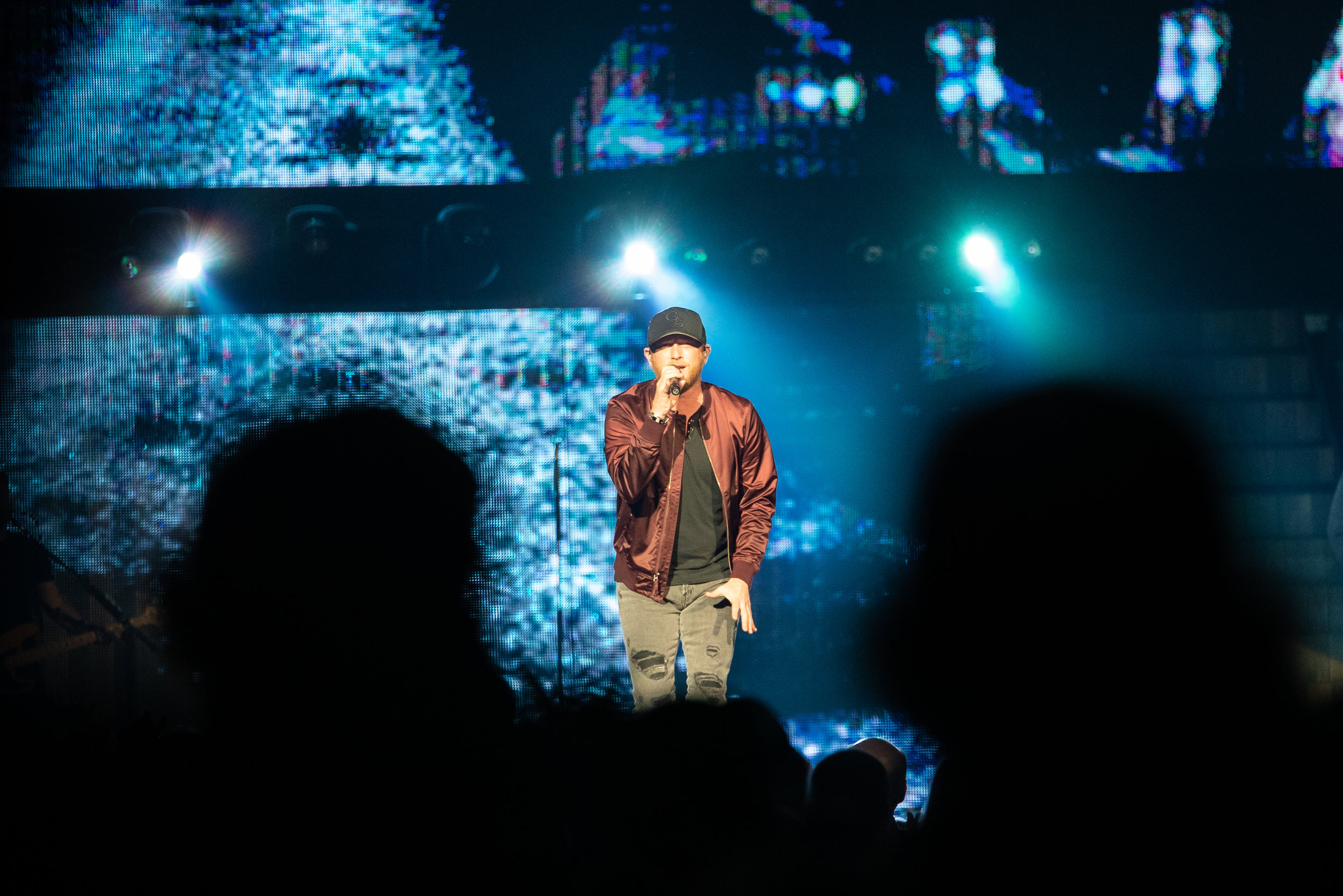 """Cole Swindell sings """"Love You Too Late"""" at the Reason to Drink Another tour on Nov. 10, 2018 at INTRUST Bank Arena."""