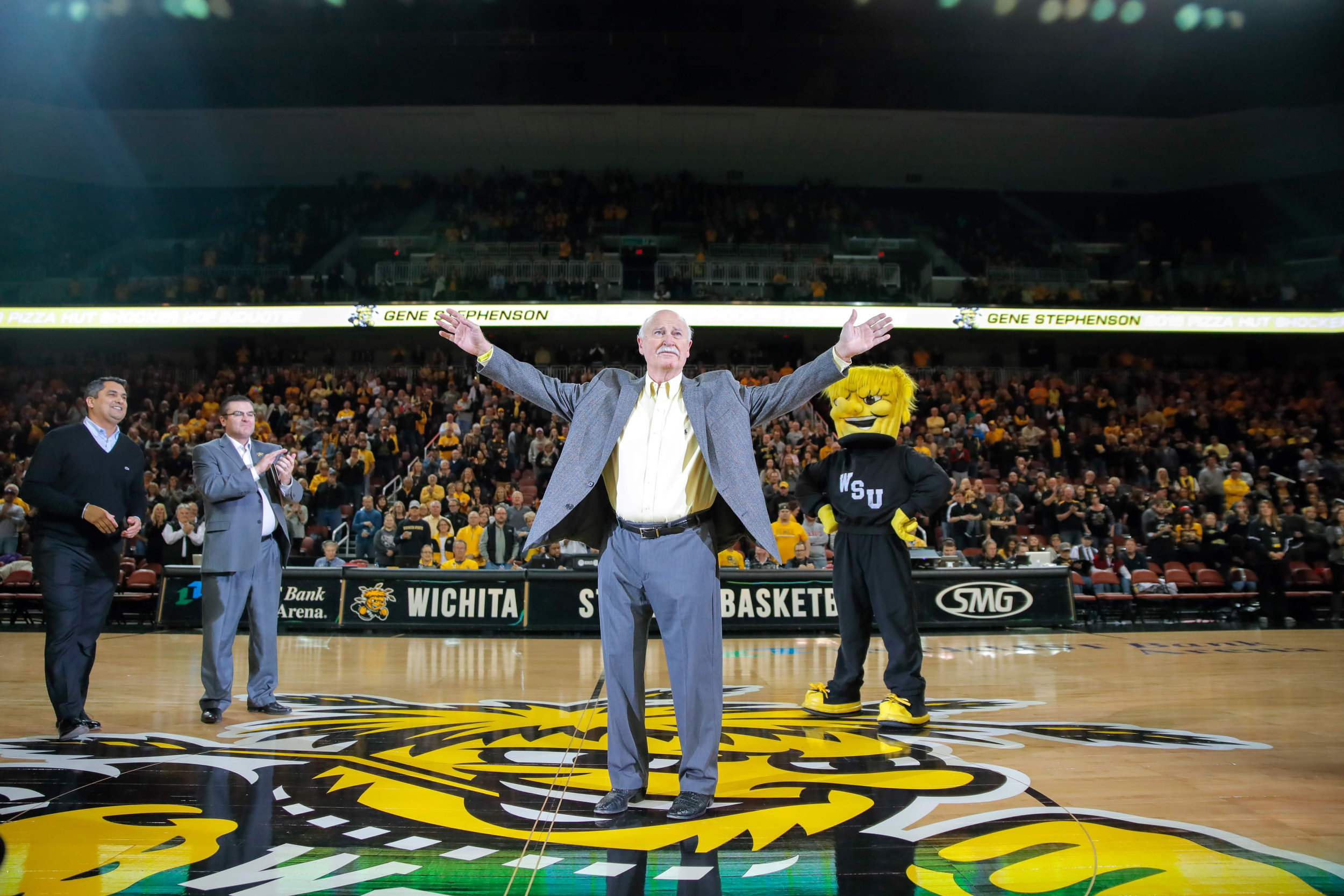 Ex-Wichita State baseball coach Gene Stephenson walks on the court at INTRUST Bank Arena in Wichita, KS. Wichita State inducted Stephenson into the Hall of Fame on Dec. 15, 2018. Stephenson led Wichita State to seven College World Series appearances, and in 1989, WSU won the College World Series.