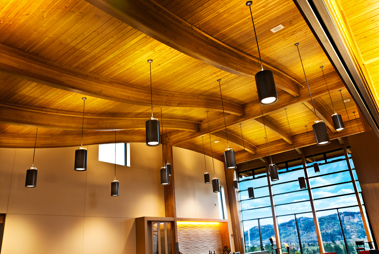 The elegant, curved beams create a sense of movement in the room.