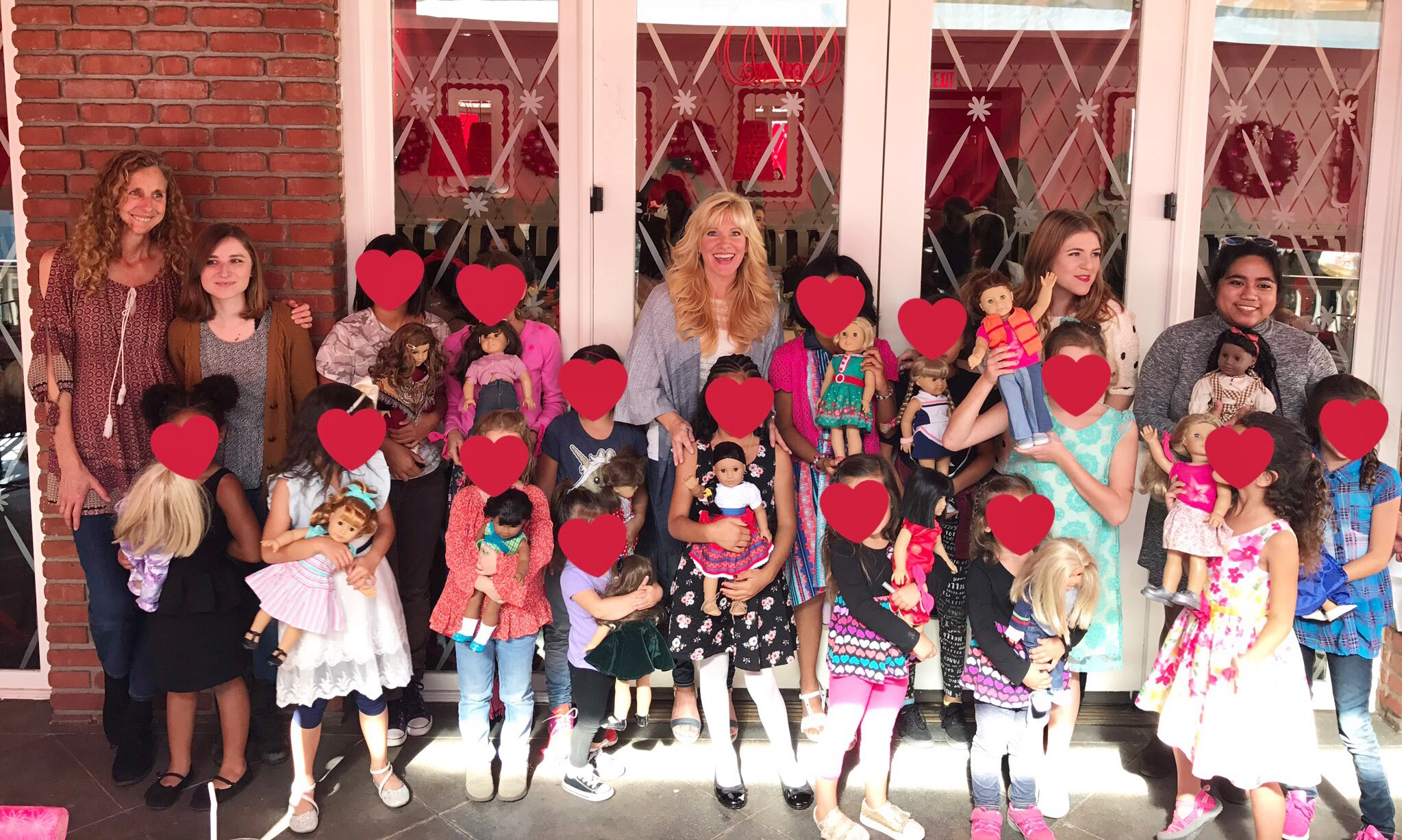 The James Storehouse Team takes a group of girls in foster care to the American Girl Doll Store.