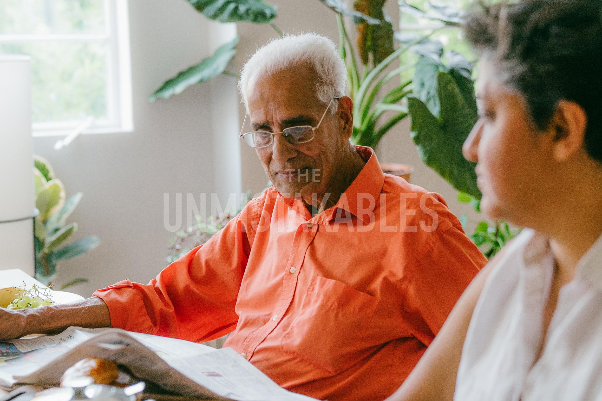 Rajan Nair - he/himRajan Nair is Manju's father, lover of newspapers and looks great in orange.