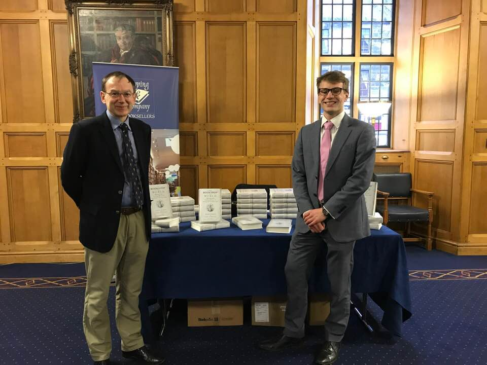The authors before the launch. The stack of books behind us was happily depleted a couple of hours later.