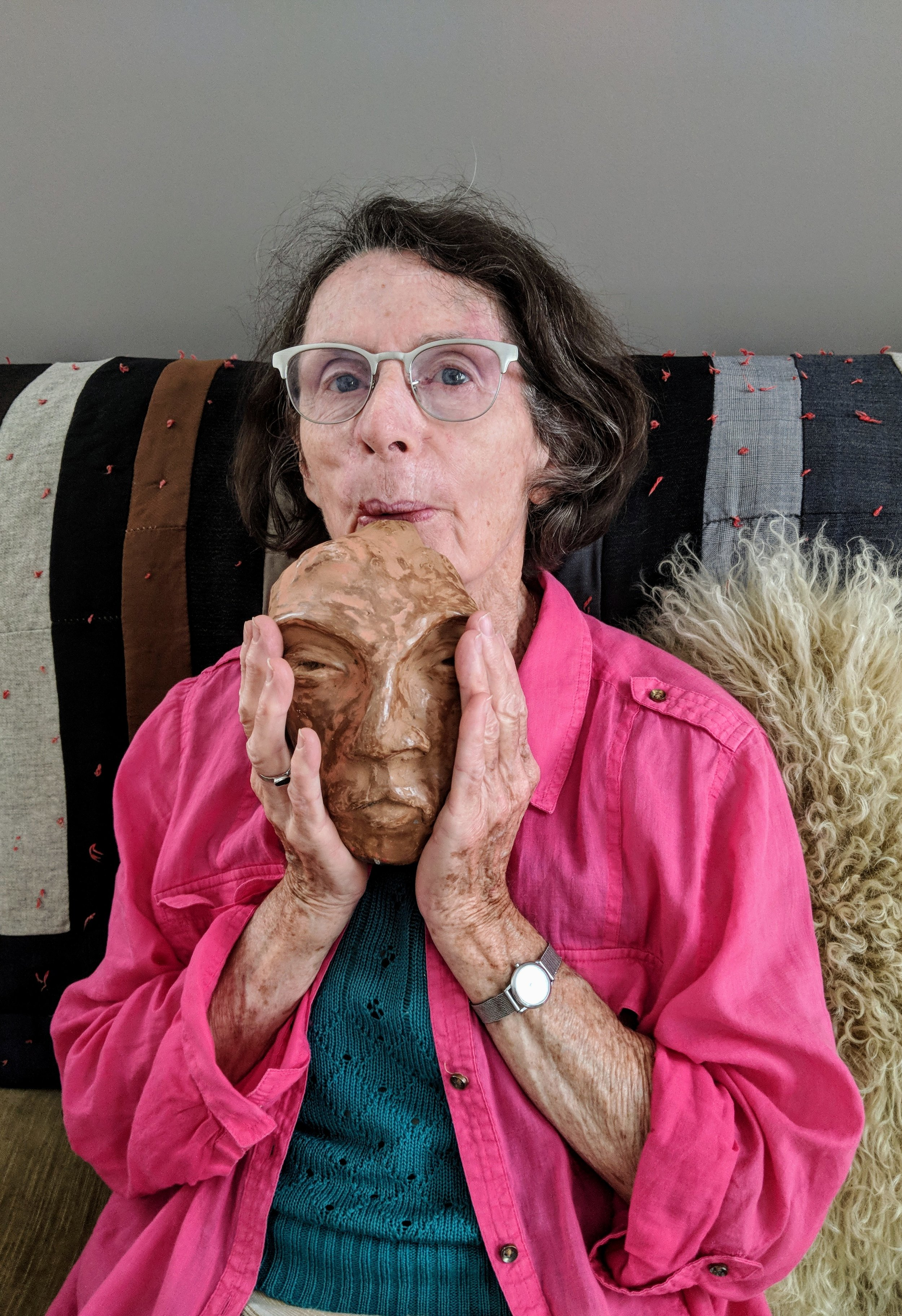 My mother, Susan Feindel, plays a flute she sculpted in the shape of her husband's face (photo from August 2018)
