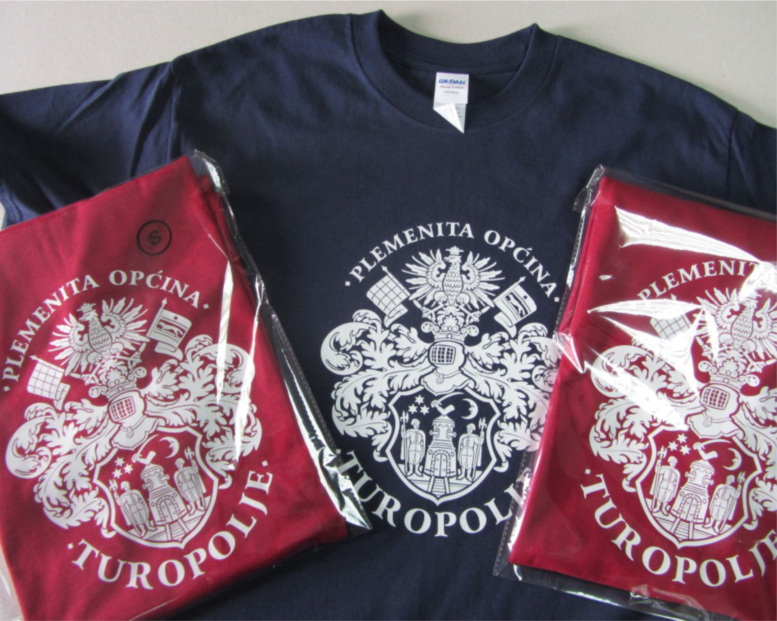 Design and production of T-shirts with your logo/crest on it.   Dizajn i izrada majica s Vašim logotipom ili grbom.
