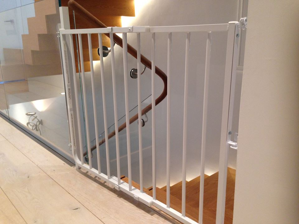 Mounting to Glass - Baby Proofing Montgomery created a mounting solution for a contemporary home that had tempered plate glass bannisters.