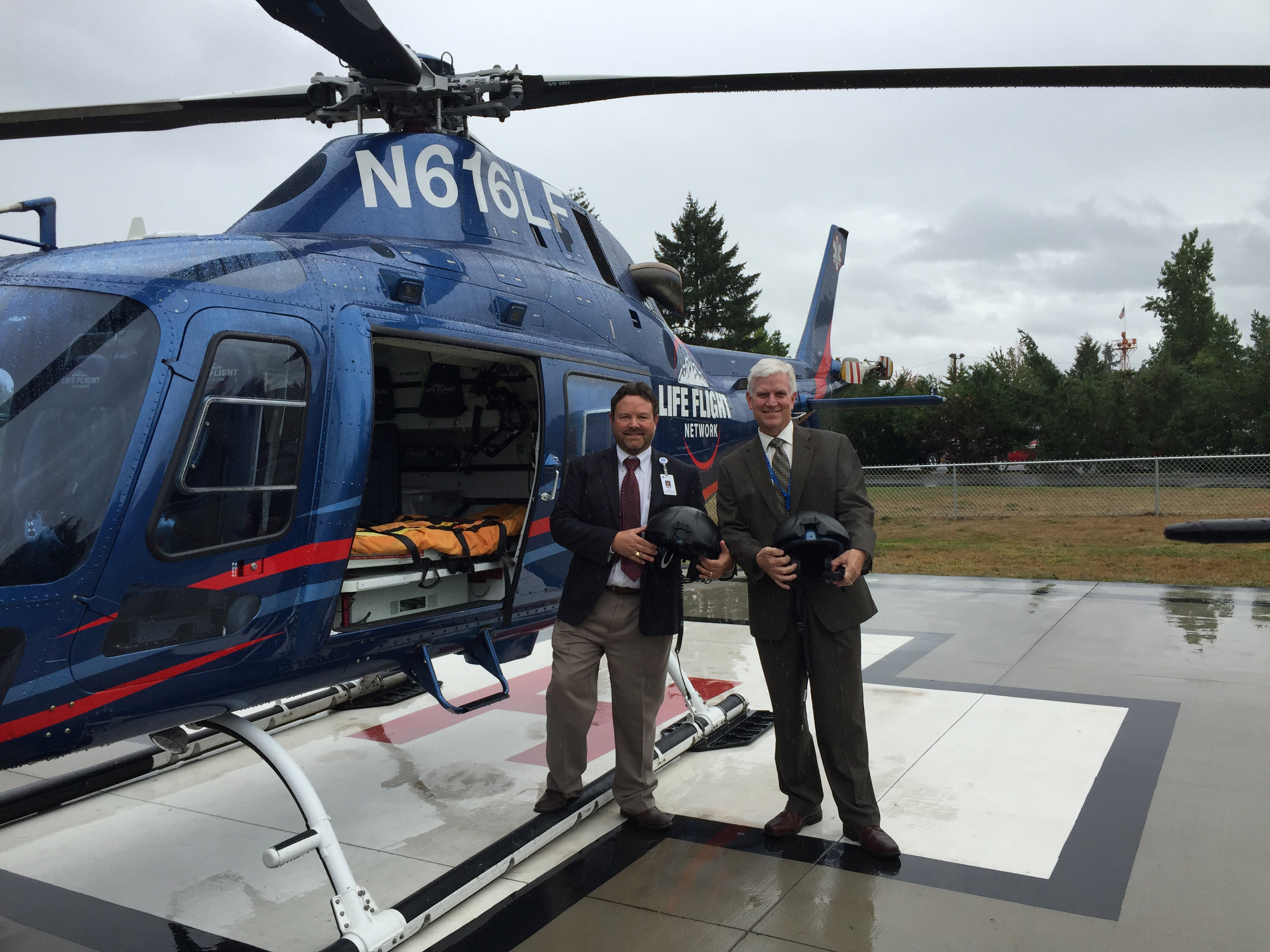Rand O'Leary with Chief Administrative Officer Tim Herrmann launches New Life Flight service for the Cottage Grove Community.