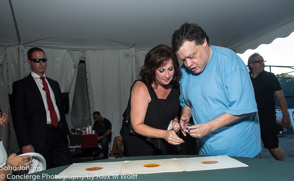 ALISHSA signing autographs for one of our VIP Room Guests in the Green Room Daytime Tent