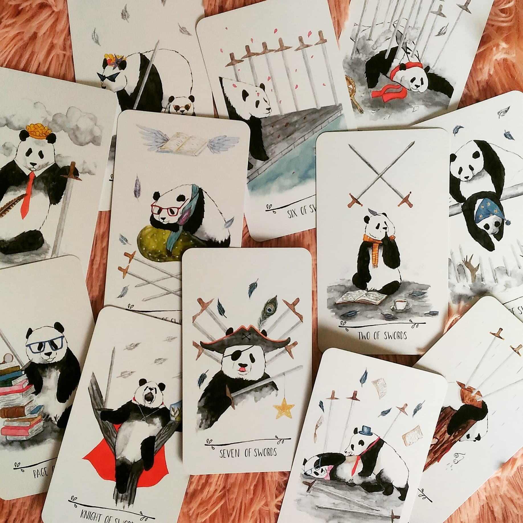 """The Suit of Swords…speaking of """"arguments"""", you can see the 5 of Swords panda really going at it."""
