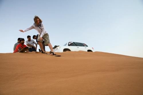 sand boarding stand up  - morning desert safari - beyond dubai.jpg