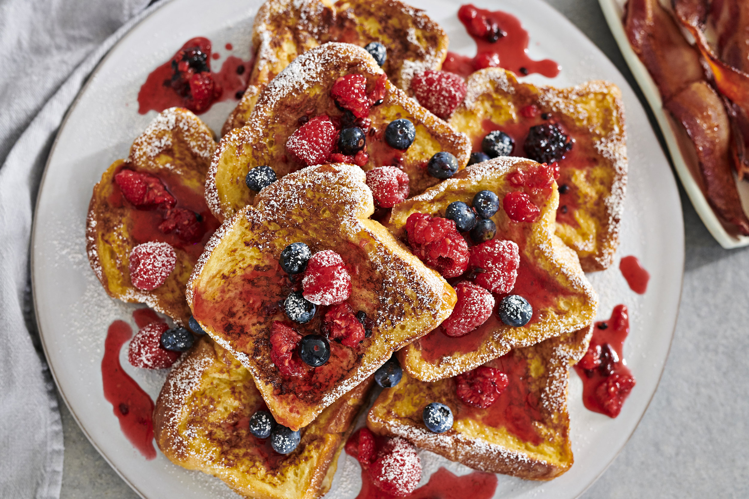 Cinnamon French Toast with Berries and Powdered Sugar