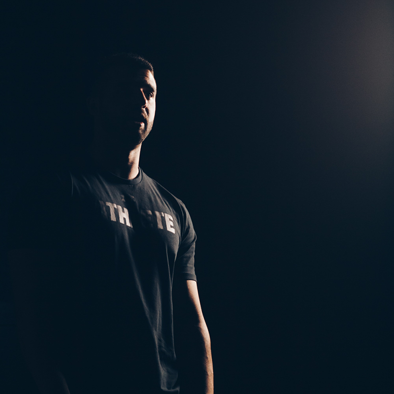 Izzy-Elubaydy-side-profile-dark.png