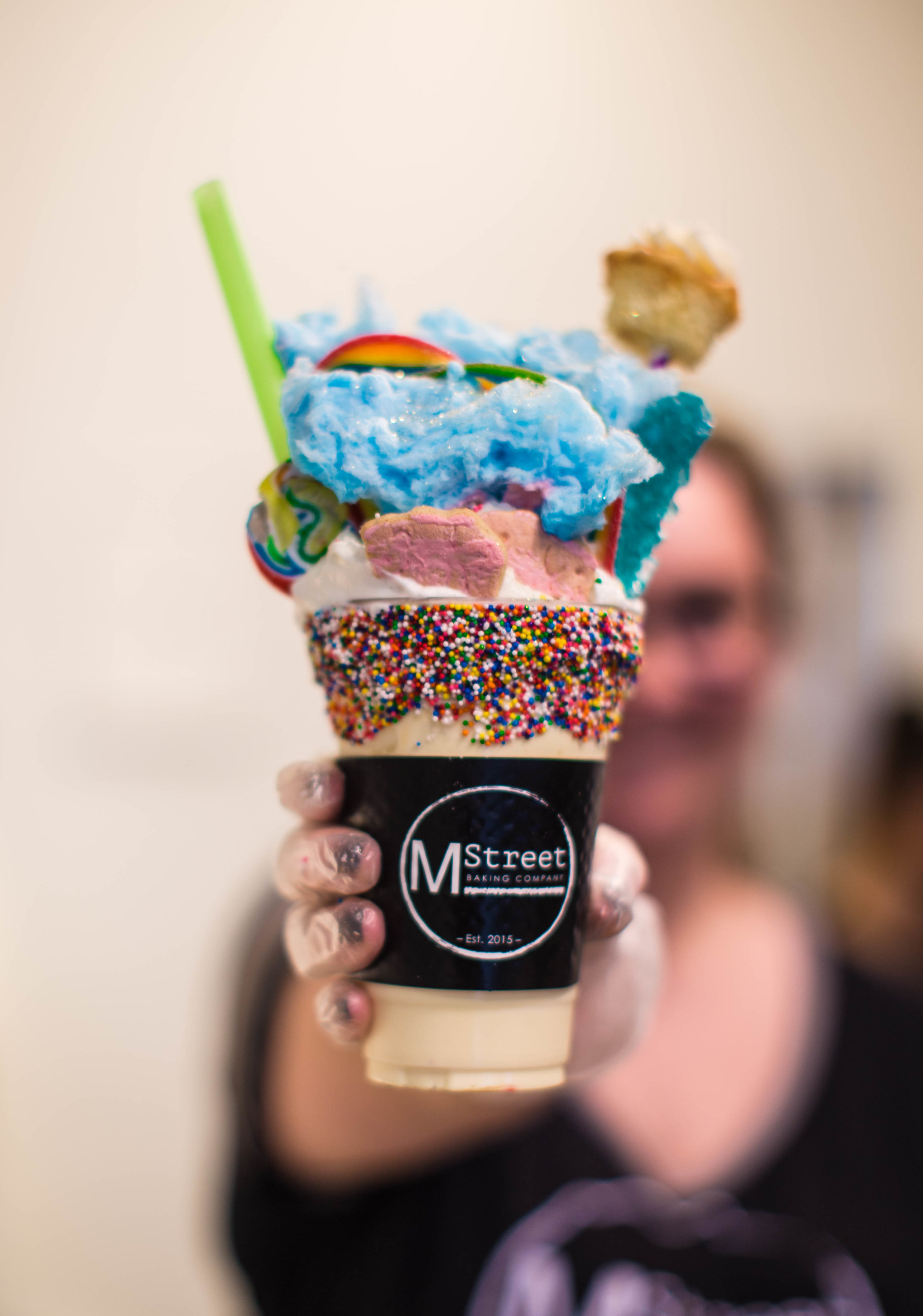 """The """"Birthday Party"""" is a birthday cake flavored shake topped with:  Whipped Cream, Mini Cupcake, Cotton Candy, Lollipop, Rock Candy, Animal Crackers, Airhead Extreme."""
