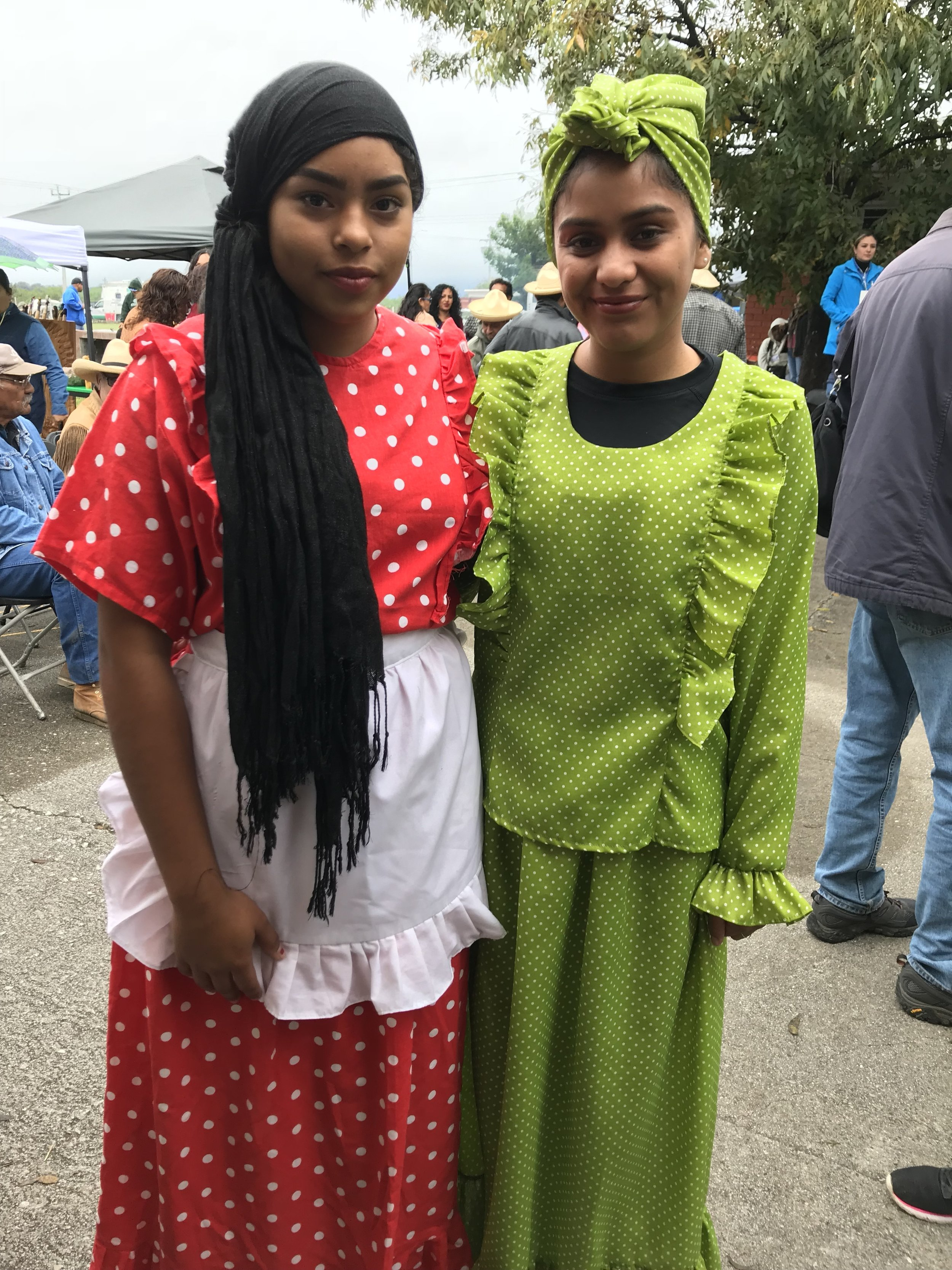 Two young women in traditional Mascogo dress.