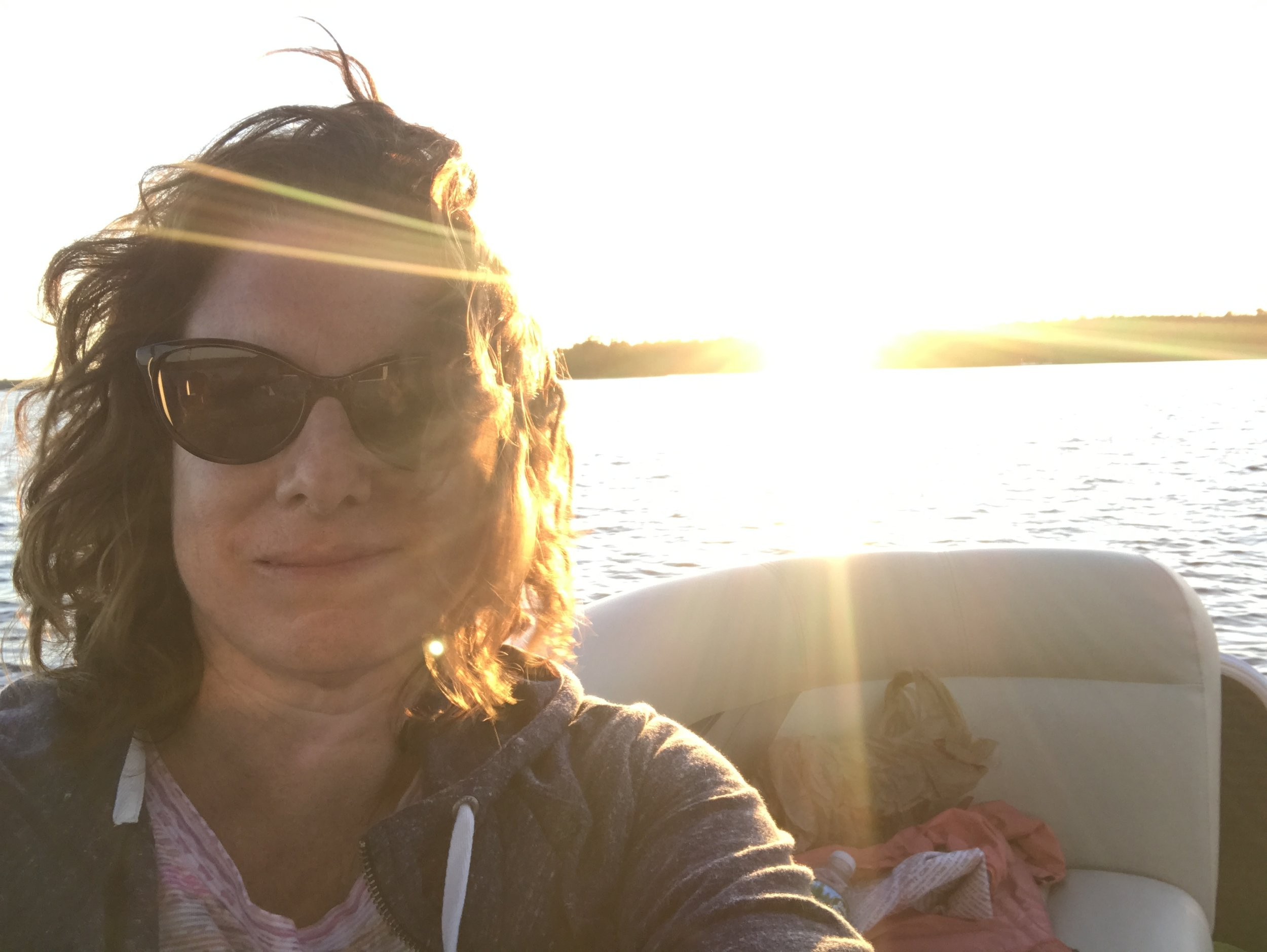 Deb Seymour, Certified Professional Coach and trained Energy Leadership Index Master Practitioner, enjoying the sunset on Moosehead Lake.
