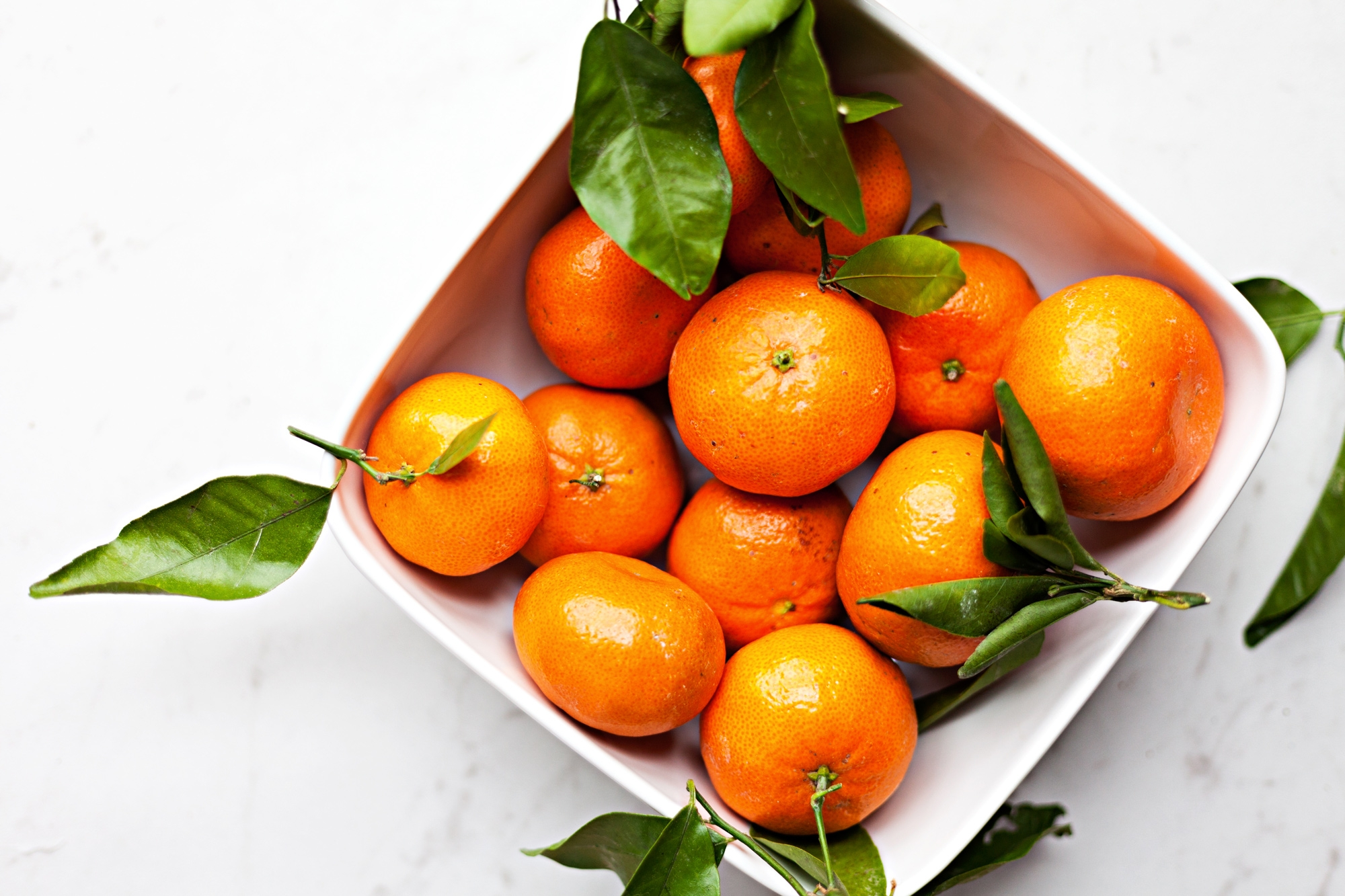 Photograph of some oranges in a bowl, part of the Food Photography series.