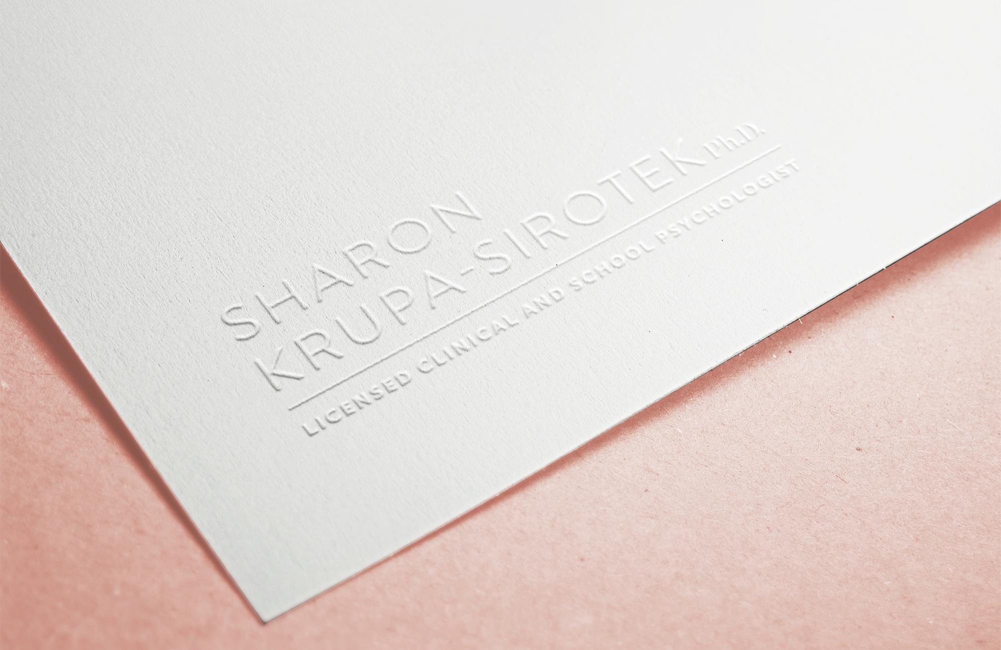 The Sharon Krupa-Sirotek logo embossed on nice paper