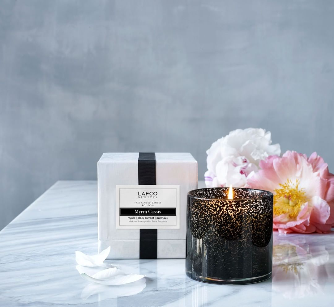 Myrrh Cassis Candle: A creamy odd-coupling of osmanthus with tobacco flower and myrrh, spiced up with black currant, cinnamon leaf, patchouli and cedar chips.