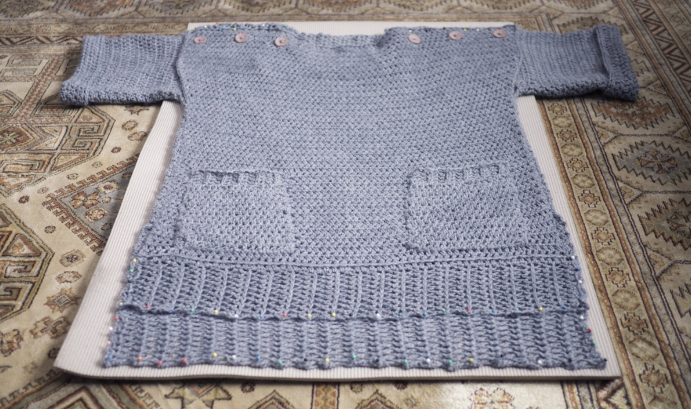 Additional pockets added at mother's request. Don't forget to block your finished sweater!