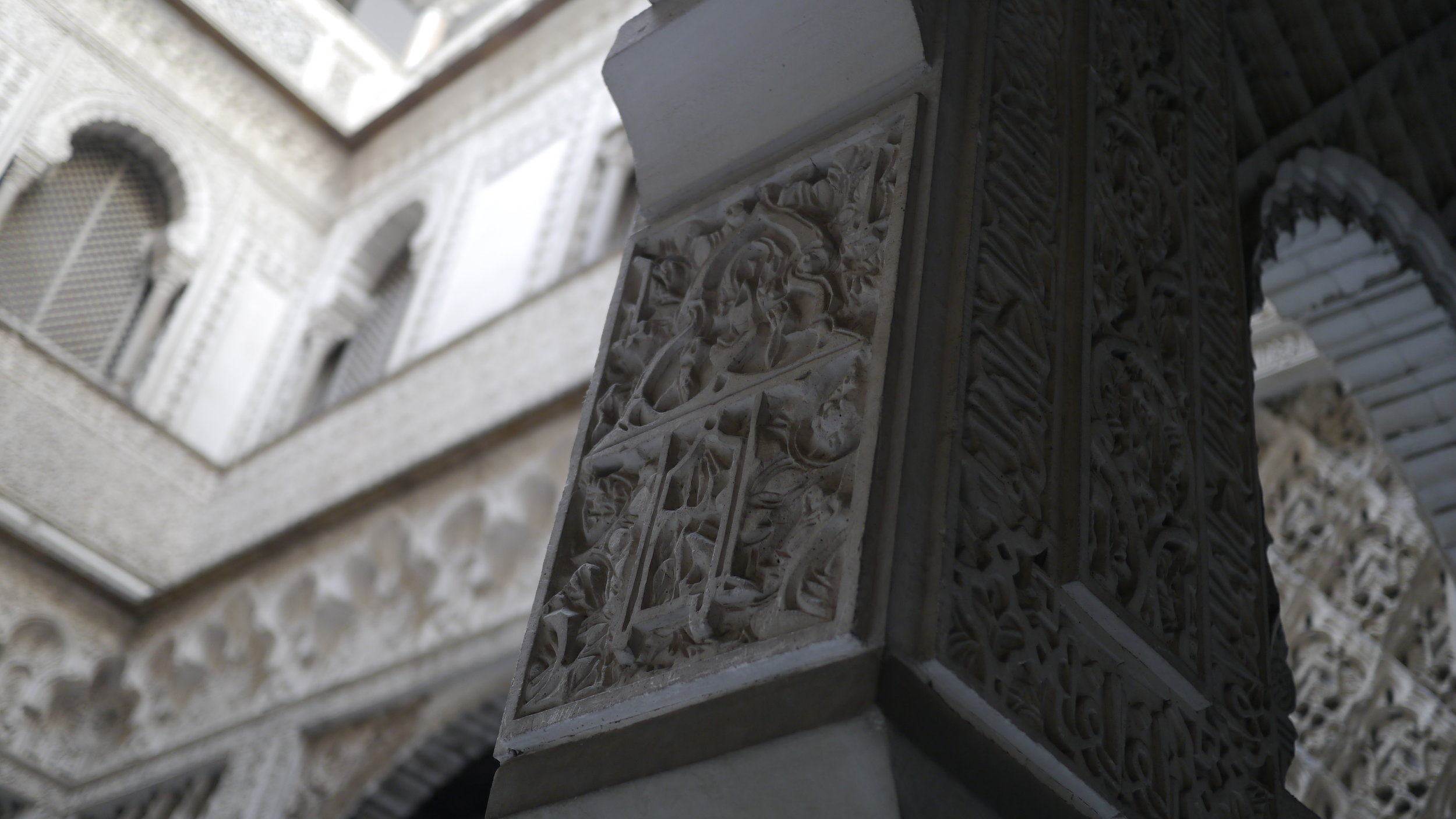 Elaborate carvings and repetition of layers upon layers of patterns in the Patio de las Munecas (Courtyard of the Dolls) at the Real Alcázar, Seville, Spain. December 2016.