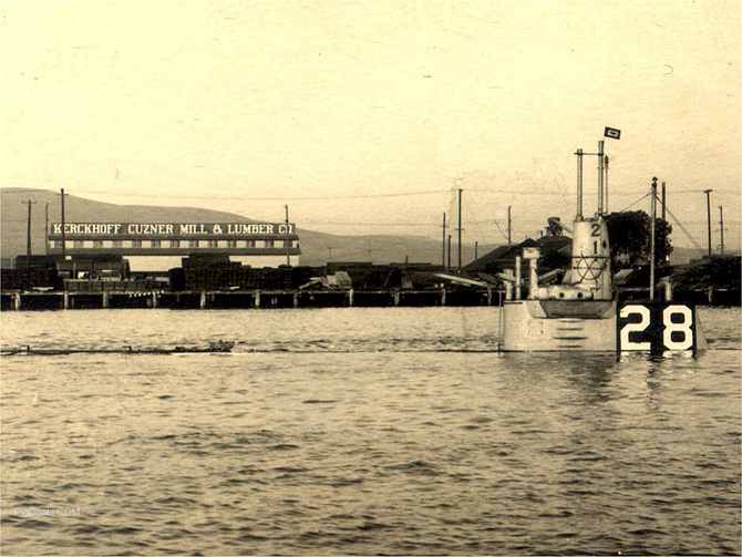 Figure 4. USS H-1 submarine conducting a static dive near the West Basin in the Port of Los Angeles. The H-1 left San Pedro in October 1917 for World War I service and was lost in 1920 on her return to San Pedro. The Kerckhoff-Cuzner Mill and Lumber Company is in the background.