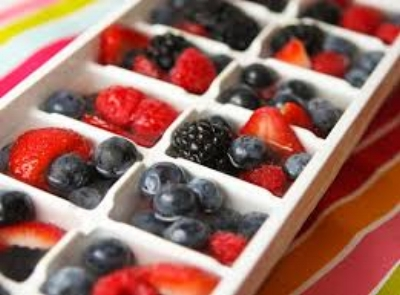 Frozen fruit in water or juice makes a delicious summer treat for your pet bird. Photo by Pip and Ebby.