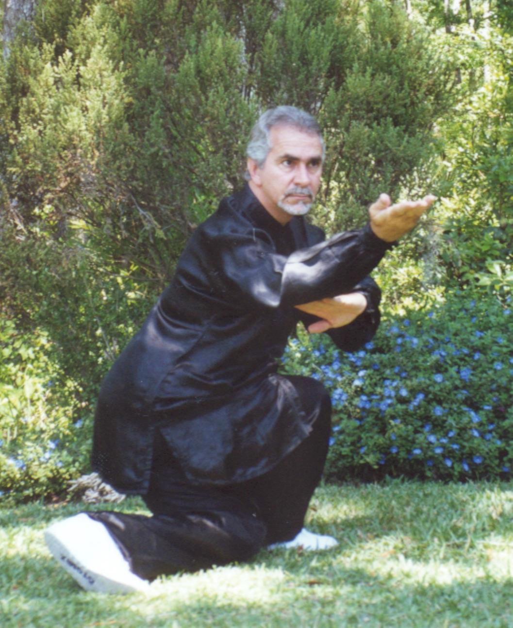 Sifu Paolillo in snake posture, late 90s