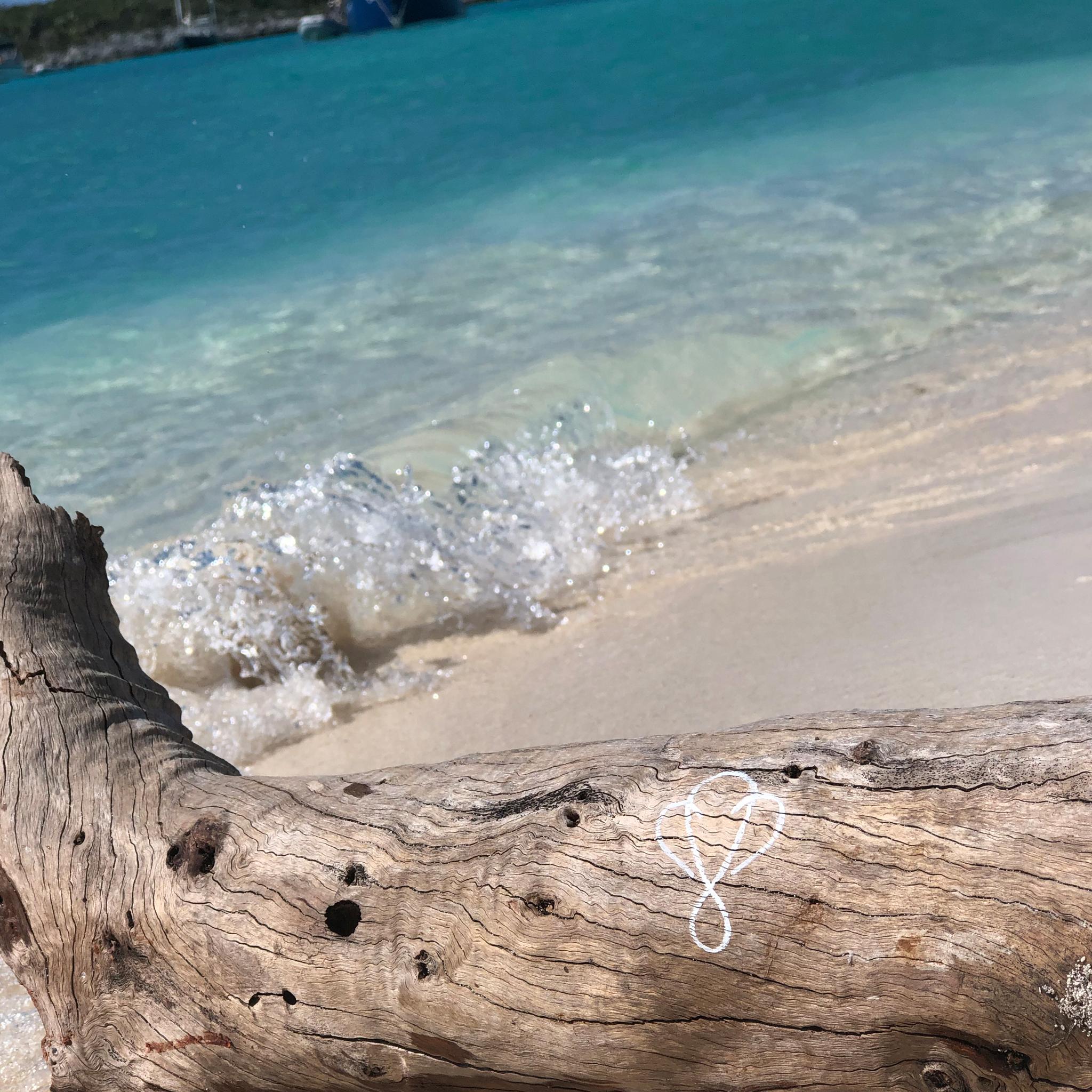 Infinite Love Logo by Big Lovie on beach in Exuma, Bahamas