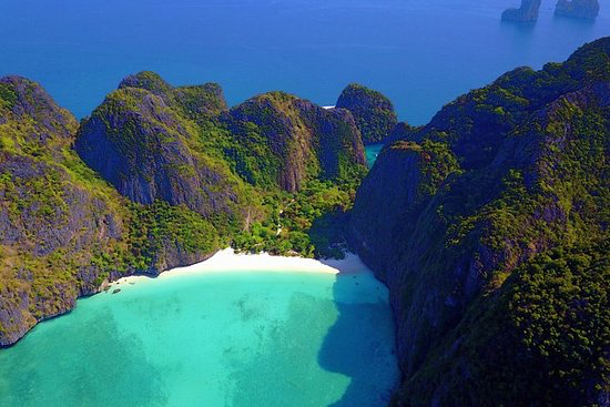 Phi Phi Island - Make the most of limited time in Thailand on a speedboat tour of the Phi Phi islands from Phuket. Traveling by speedboat means you'll spend less time at sea and more time exploring the white sands and crystal waters of the islands, home to the bay made famous by The Beach