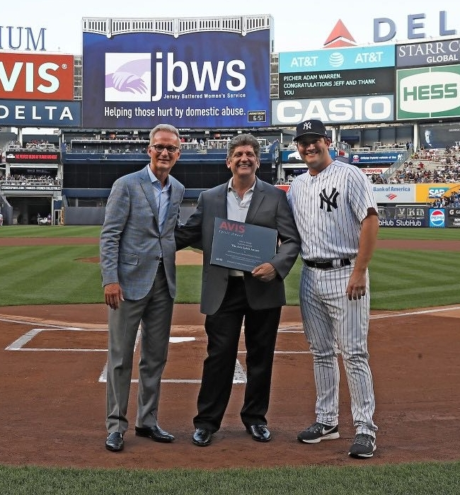 """Having had a successful career, a good family life, and being blessed with the time and ability to 'give back', I find such reward and personal value in helping JBWS do the great work they do.""  Jeff Simon, pictured Center, receiving the ""2018 Avis Spirit Award"" at Yankee Stadium for his volunteer work with JBWS in Morris County."