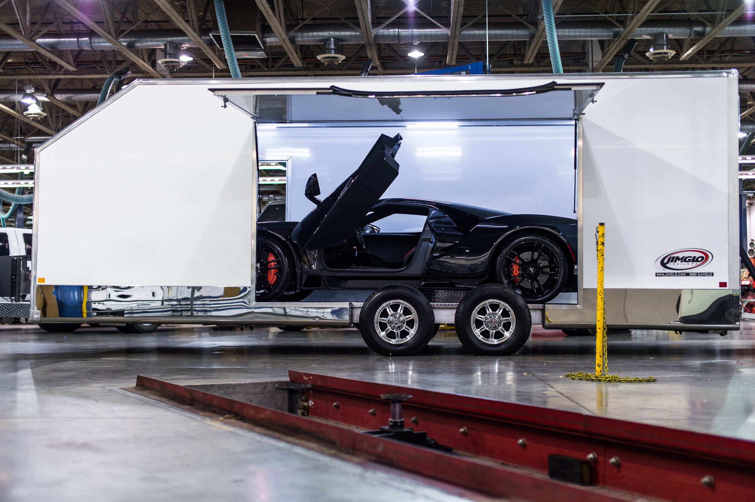 """FUELED BY DESIGN - """"We looked at multiple different options, but JIMGLO's ramp design and unique side hatch offered maximum protection for the GT, while ensuring easy driver exit during loading"""" explained Kurt Kiser, Parts and Service Program Manager for the Ford GT. """"This trailer is the perfect complement to the no-compromises GT."""""""