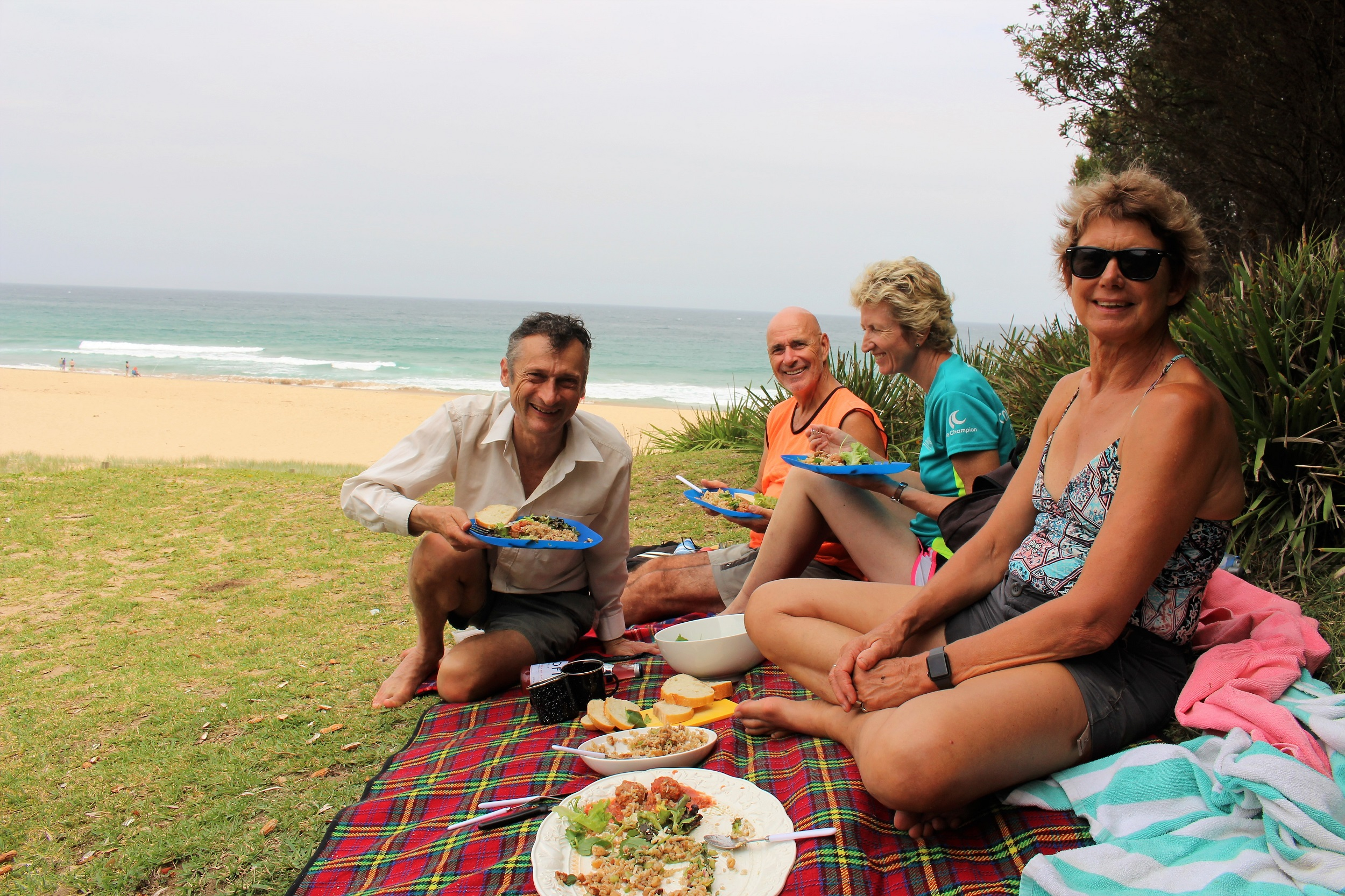 Smiles all round for a picnic lunch of rice salad, meatballs, rocket, avocado and chicken salad and fresh Italian bread