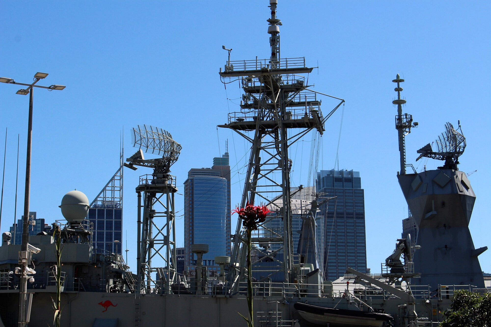 power of one plus Australian navy vessel and Sydney city