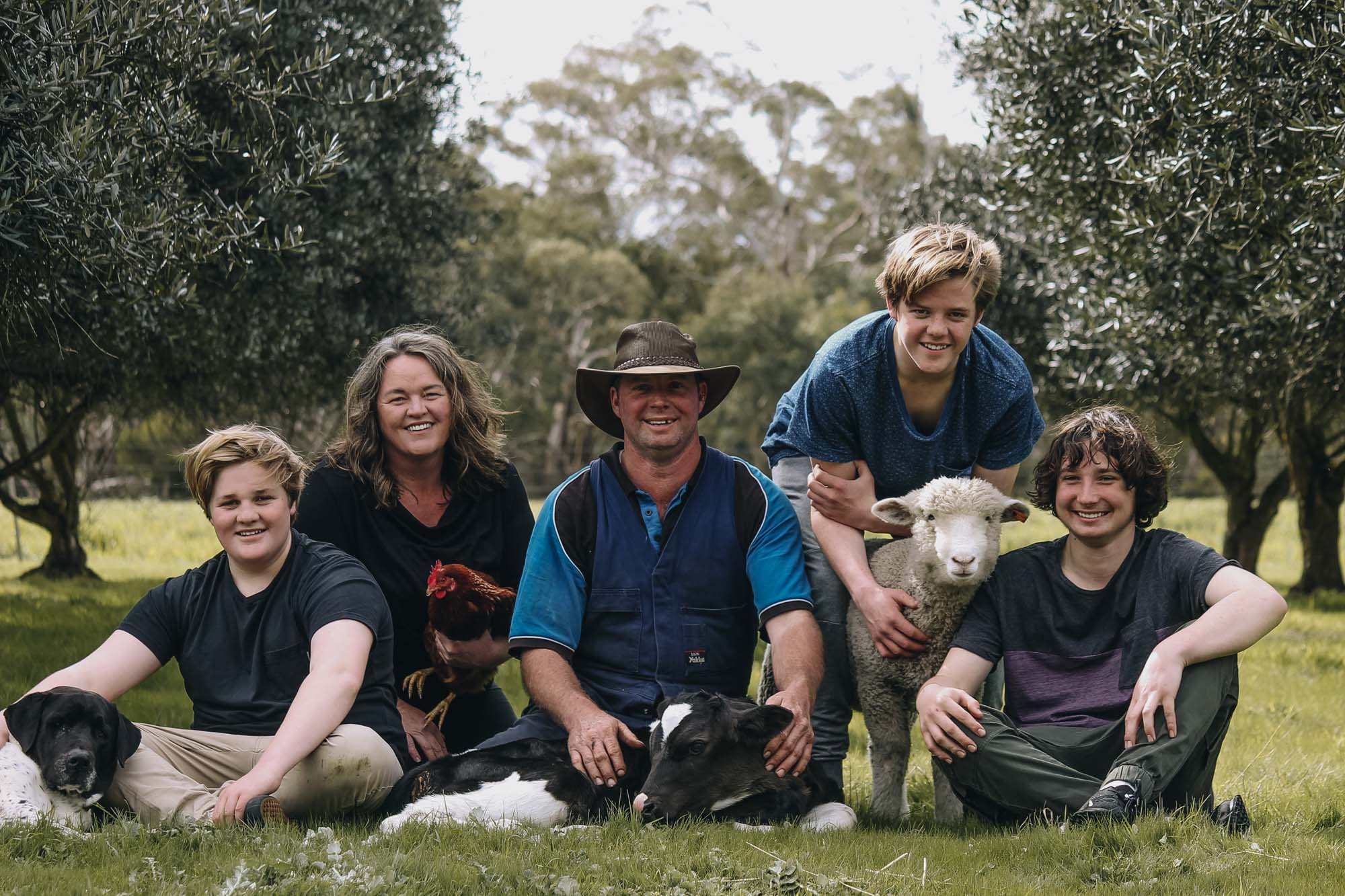 Marissa and Phillip with their three sons, Jack, Tom, Zeb and Charlie the dog.