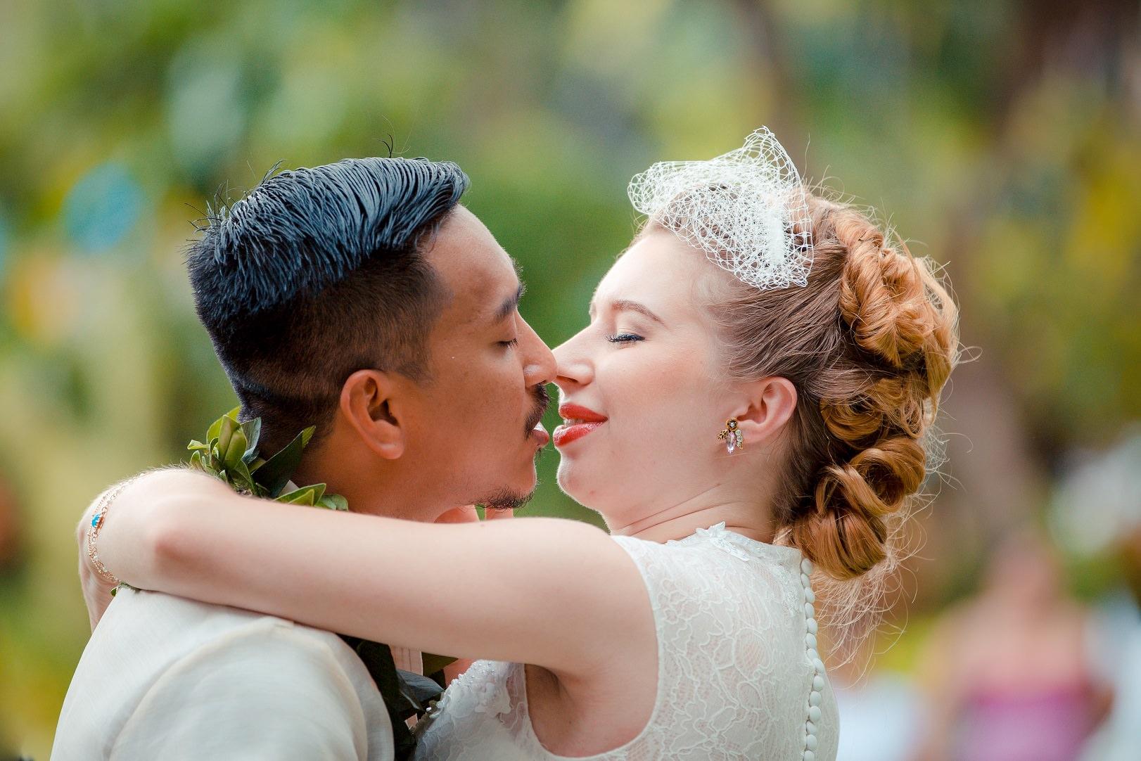 wedding kiss bride groom hale koa hotel resort waikiki oahu hawaii