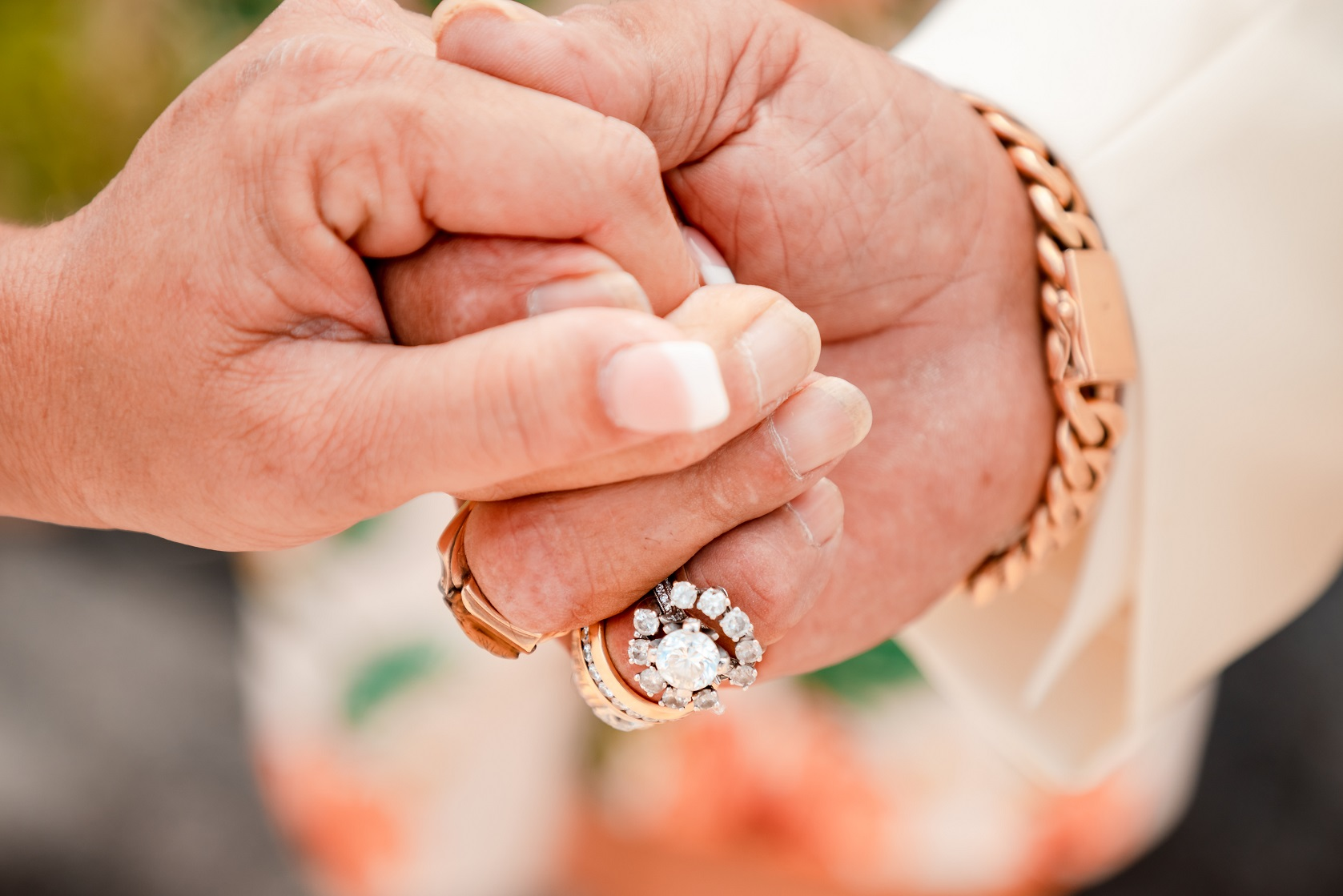 groom holding brides hand wedding rings ceremony