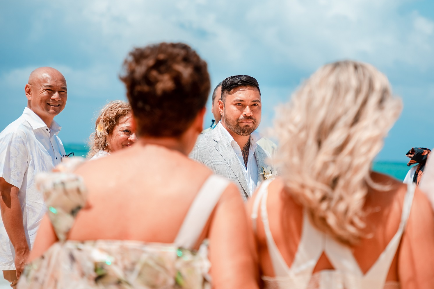 grooms first look at bride oahu beach wedding elopement