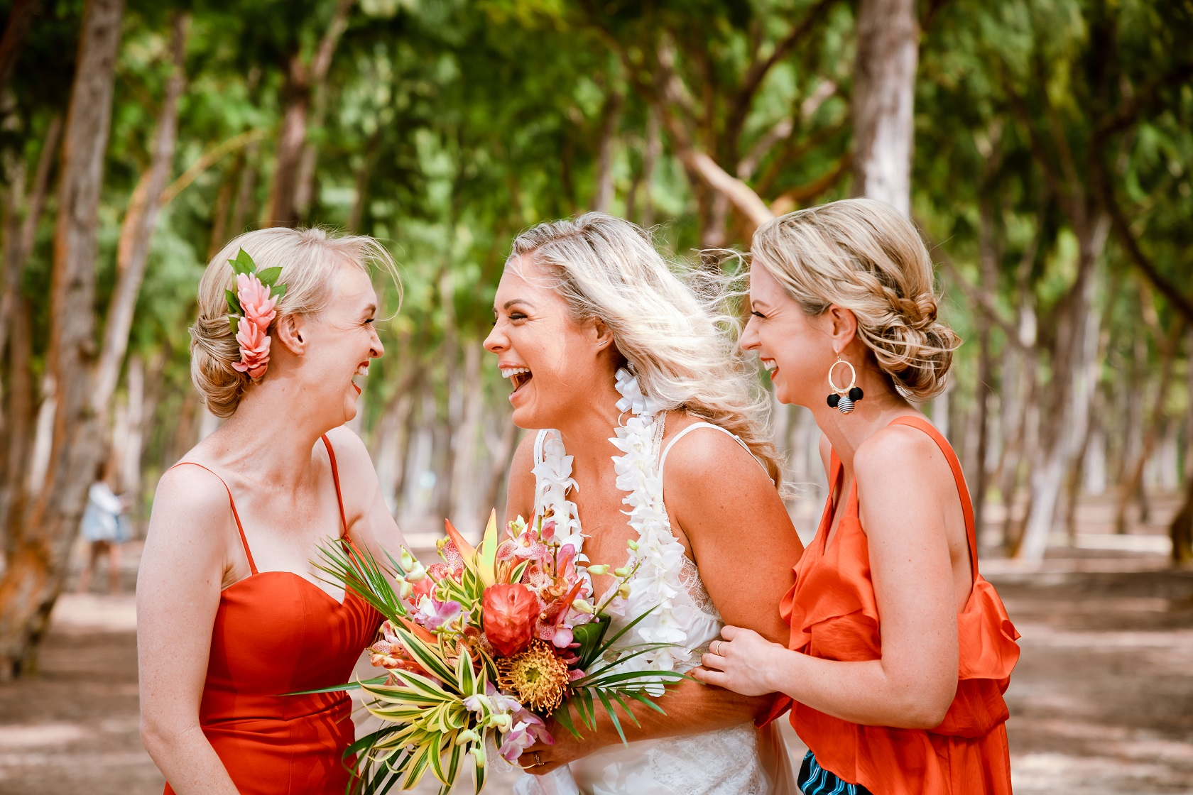brides and bridesmaids laughing oahu wedding ceremony