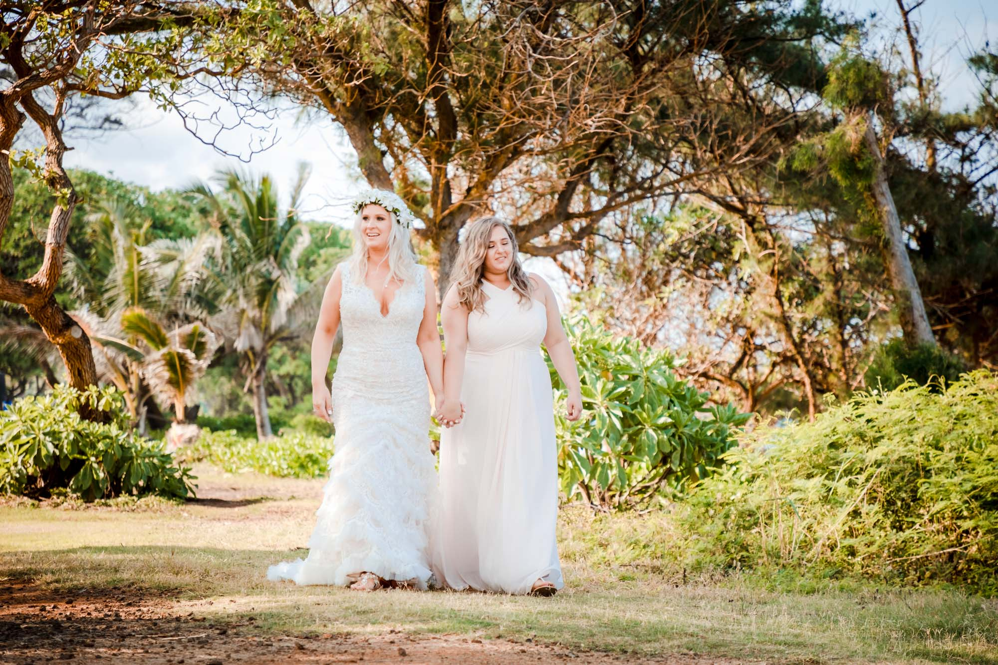 bride walking with daughter wedding dress kauai elopement