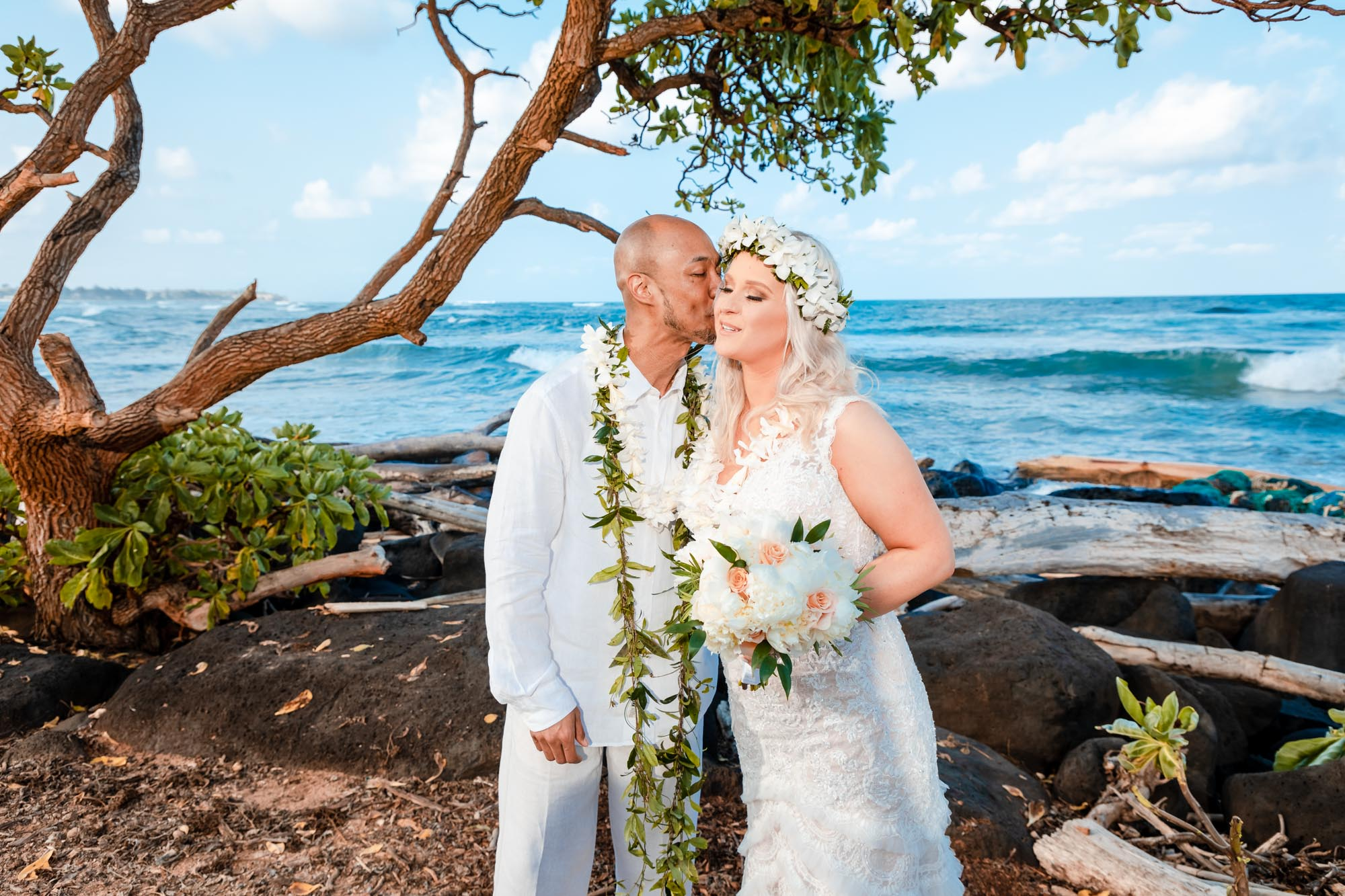 bride and groom wedding kiss beach elopement kauai