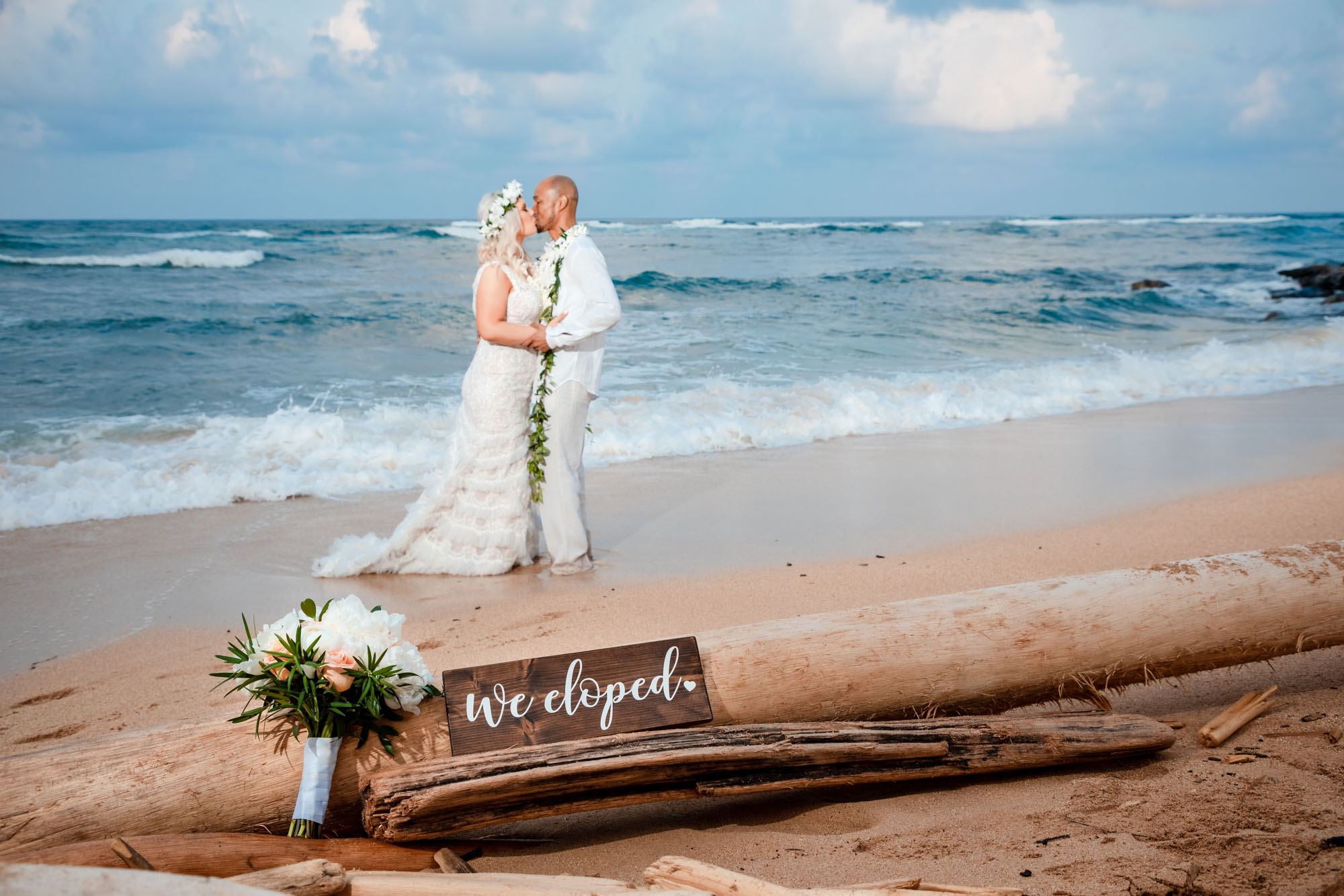 bride groom we eloped sign beach ocean kauai sunset