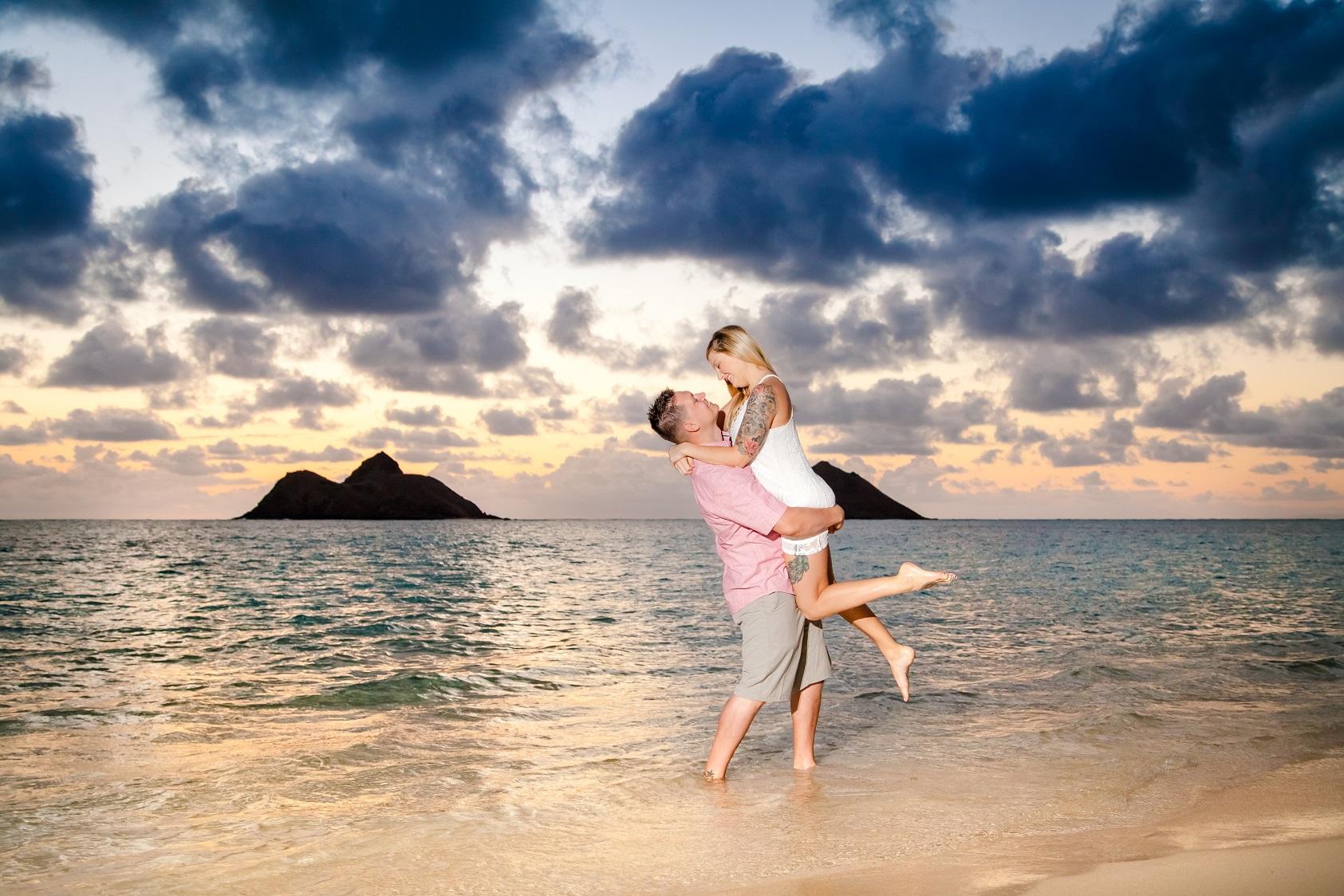 romantic couples beach engagement portrait hawaii sunrise