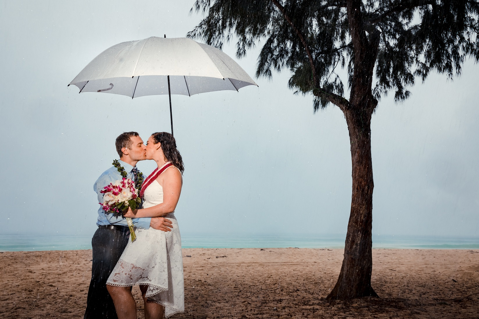 raining day hawaiian beach wedding umbrella