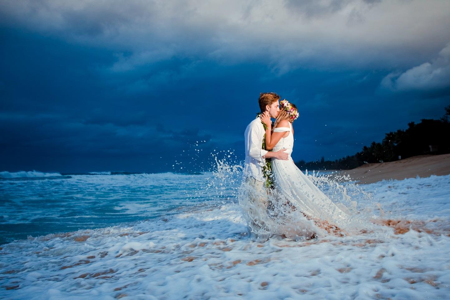 bride and groom sunset beach waves surf wedding portrait