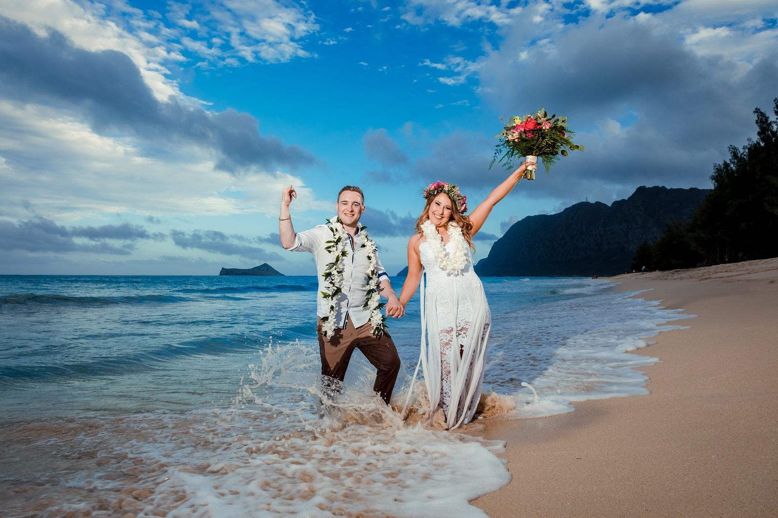 bride groom wedding portrait beach sunset waves splash